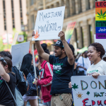 People at the Twin Cities Pride Parade supporting marijuana legalization