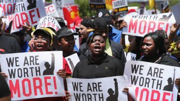 Activists demonstrate for a higher minimum wage.
