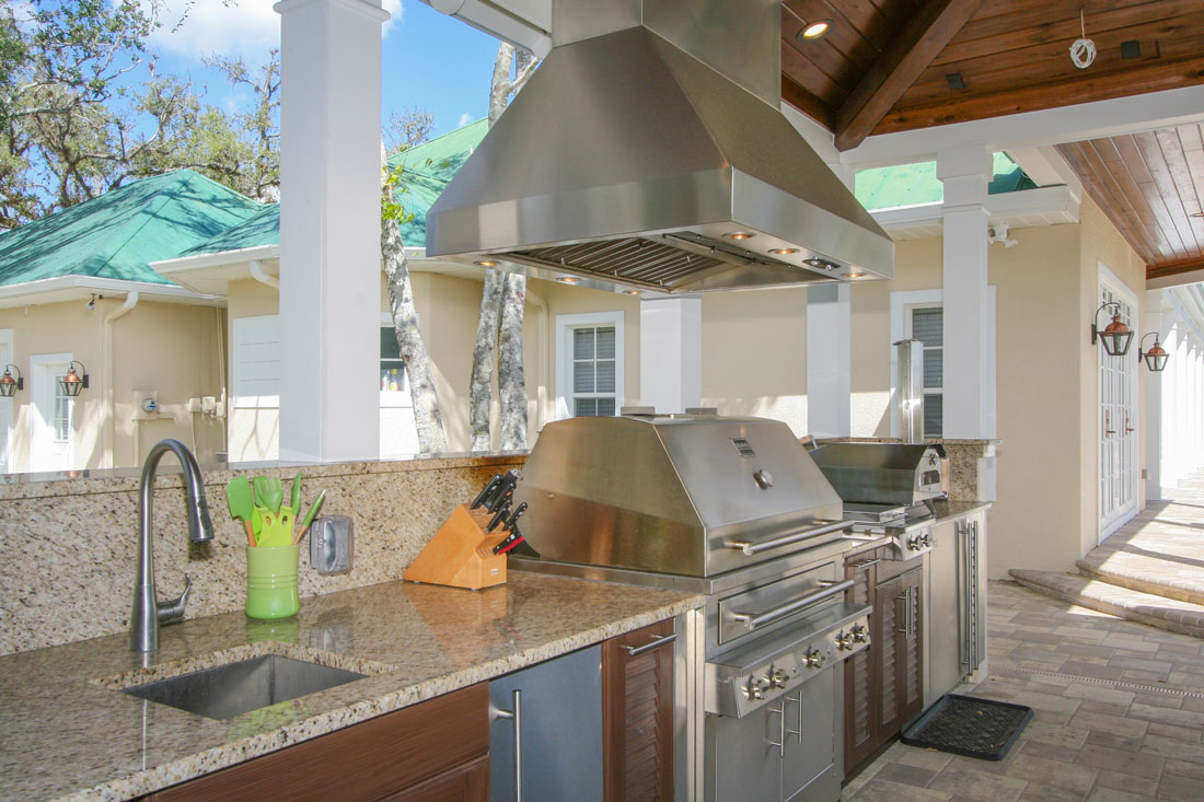 outdoor kitchen hood counter height table and chairs alva fl living area w progressive design build space remodel in florida by