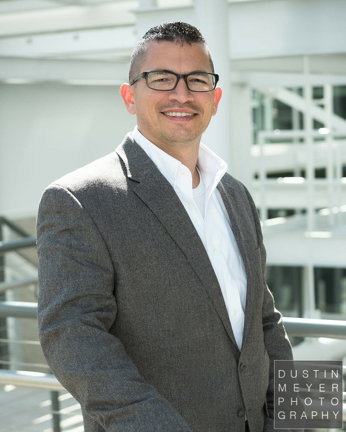 professional headshot tips male business headshot glasses and gray suit outdoors industrial modern contemporary headshots