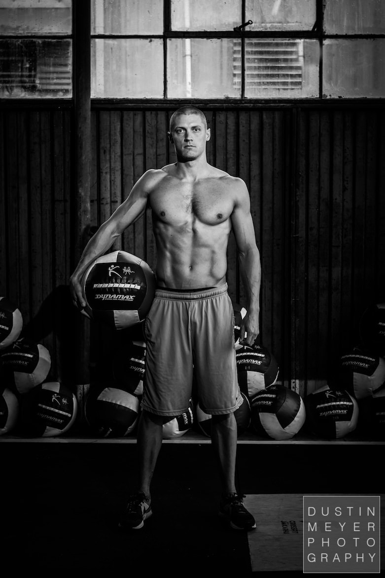 male fitness model in black and white at a crossfit workout