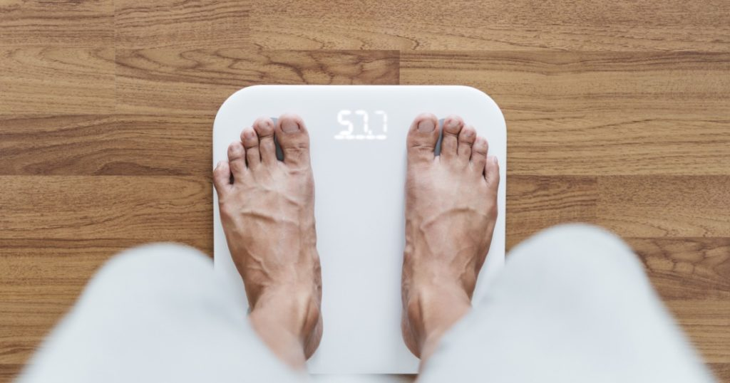 man-using-scale-feature-1024x538 Can eating too little actually damage your metabolism? Health Tips