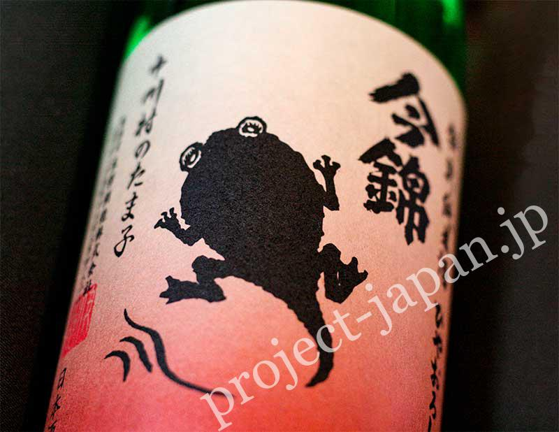 "Tokubetsu junmai-shu ""Nakagawamura no Tamako"". The illustration on the label is a tadpole in Tanada (terraced rice-fields) where the brewer harvests rice."