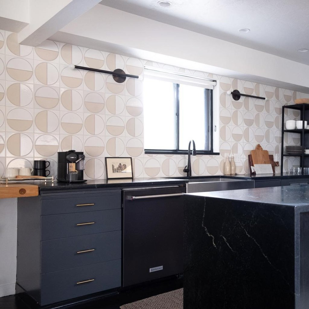Kirsten Grove family kitchen featuring geo backsplash, soapstone countertops and black matte accents.