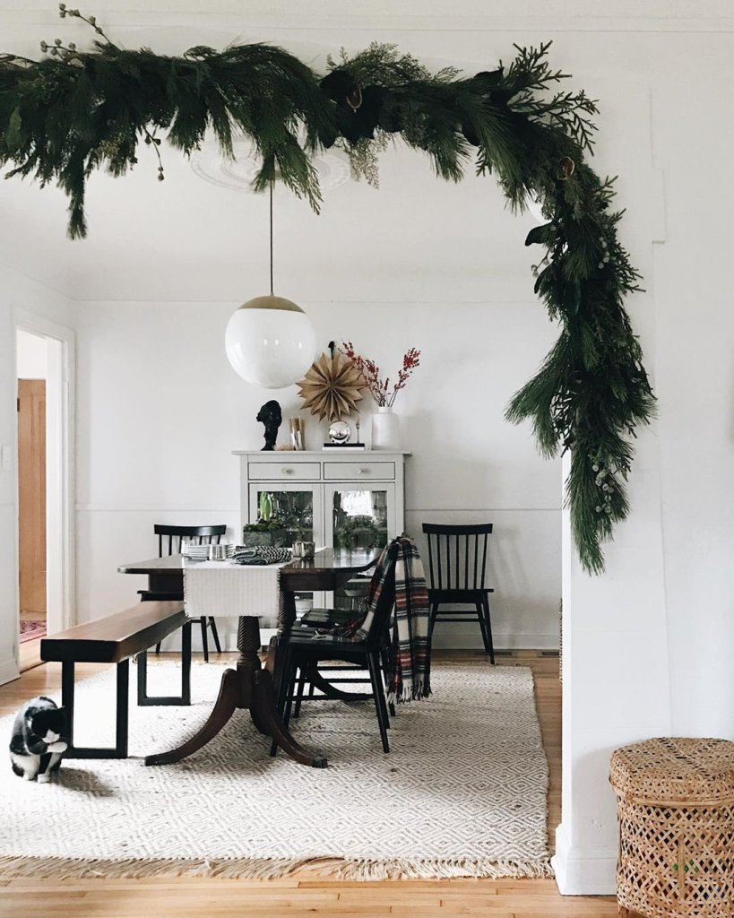 dining room with garland over entrance