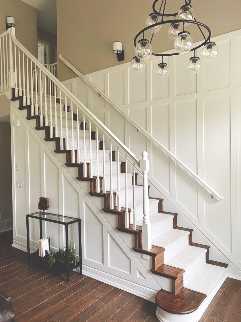 Updated staircase with wood stairs and floor runner.