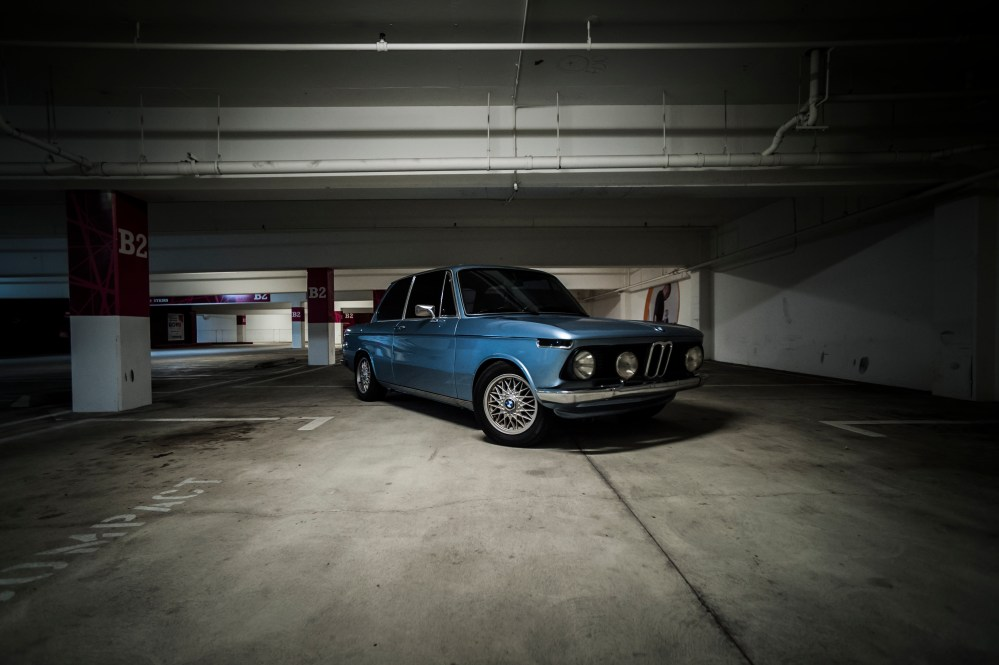 1976 BMW 2002 fjord blue parking lot