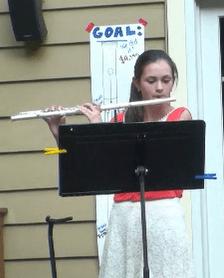 Alexandra playing her flute.