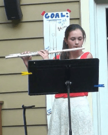 Alexandra playing her flute.