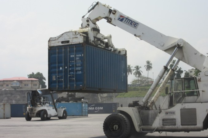 A container being transported by vehicle.