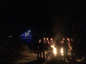 Caroling around a bonfire under the stars.... doesn't get much better than this