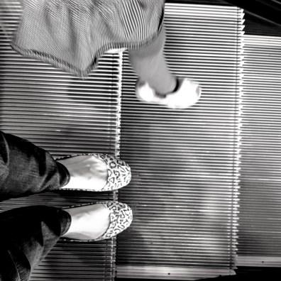 Standing on the escalator, little feet climb down NotSoSAHM Black and White