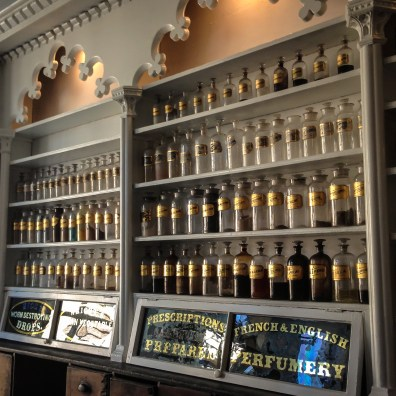 Jars of herbs and medicine line the shelves of an apothecary in Alexandria, VA Not So SAHM
