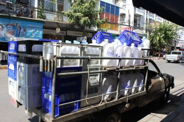 Water delivery trucks (it's not safe to drink the tap)