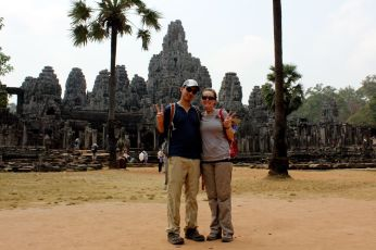 typical asian peace sign in front of places (angkor wat)