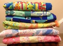 A stack of recently donated quilts