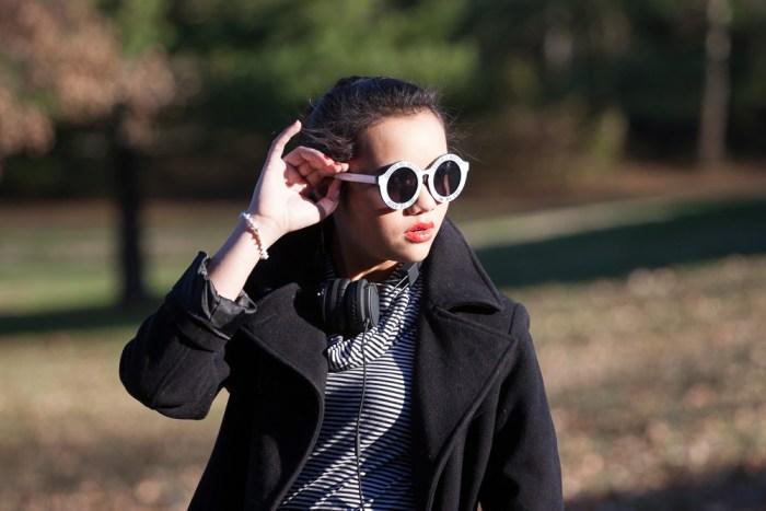 Glasses--$10, Sunglass Spot. Headphones--$60, Urbanears. Cowl Neck Shirt--$10, Plato's Closet. Long Coat--Anne Klein.