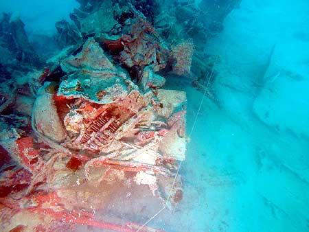 avenger wreck lit by dive light in palau by bentprop