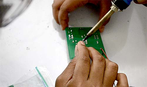 students learn to solder