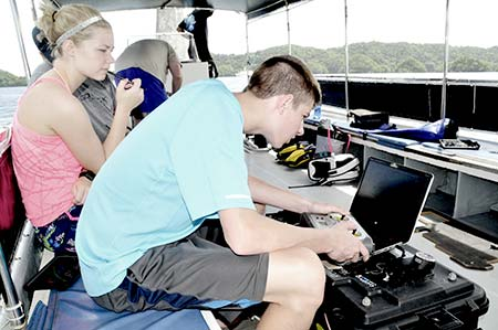 uva operators flying underwater on dive boat palau with bentprop