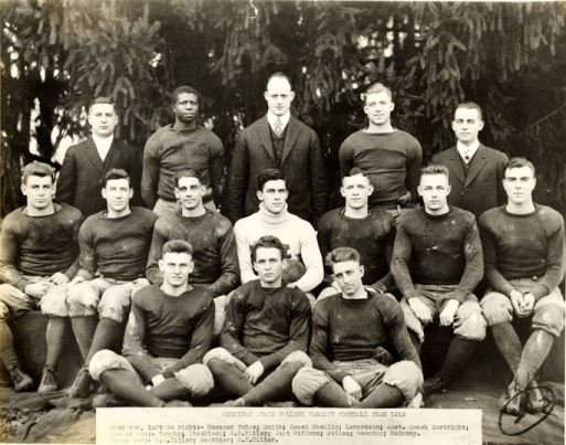 Michigan State College Varsity Football Team 1913. Smith is the top row, second from the left. Tellingly, his name is excluded from the text caption on the photograph. Image courtesy of MSU Archives and Collections.