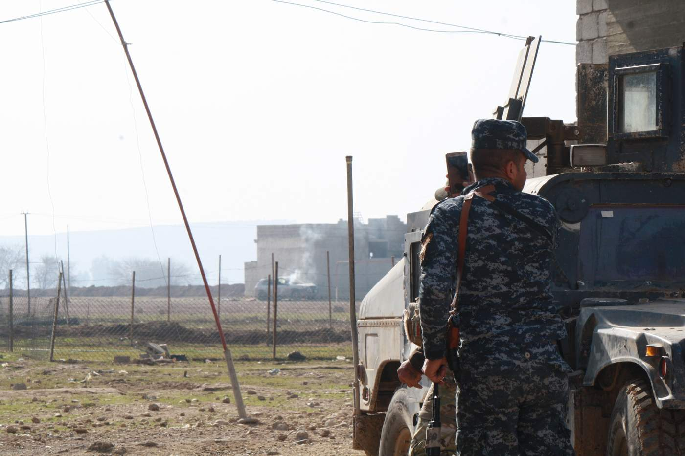 Iraqi soldiers blow up an IS car laced with bombs the day after capturing this area of Mosul, Iraq on Jan. 13, 2017. (H.Murdock\/VOA)