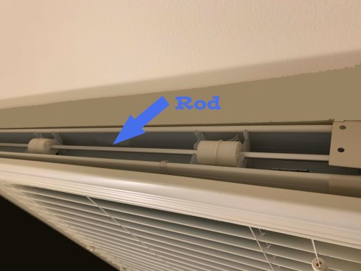 Rod within the window valance indicated by a blue arrow