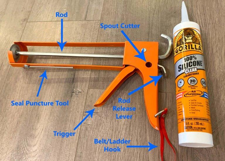 Diagram showing the parts of an orange caulk gun with blue arrows next to an orange bottle of caulk
