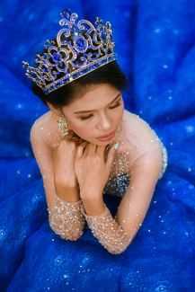 Women in blue dress and blue tiara