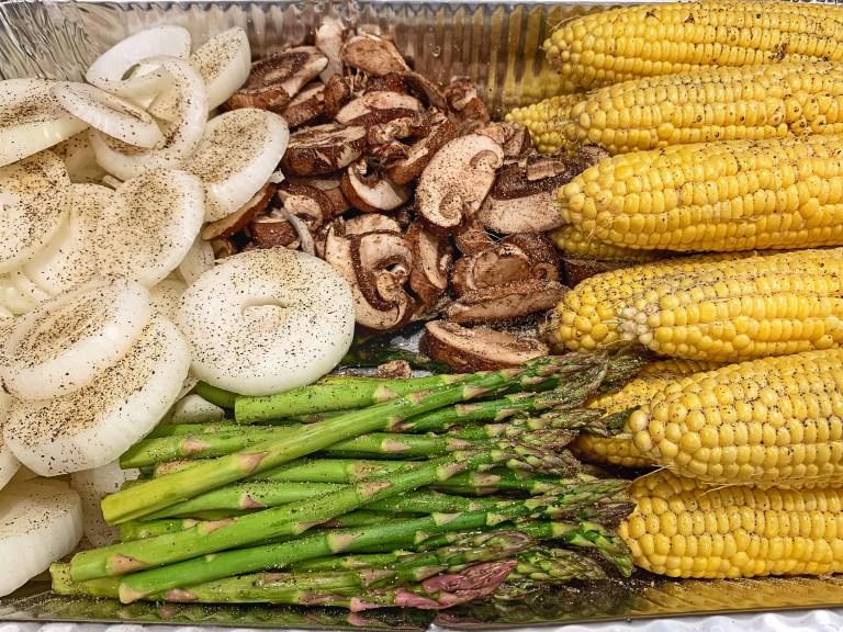 Corn, portobello mushrooms, onions, and asparagus seasoned with salt and black pepper