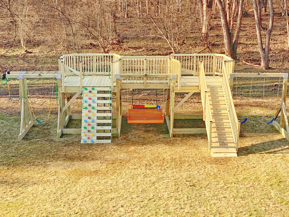 playground with swings and monkey bars, wood not stained