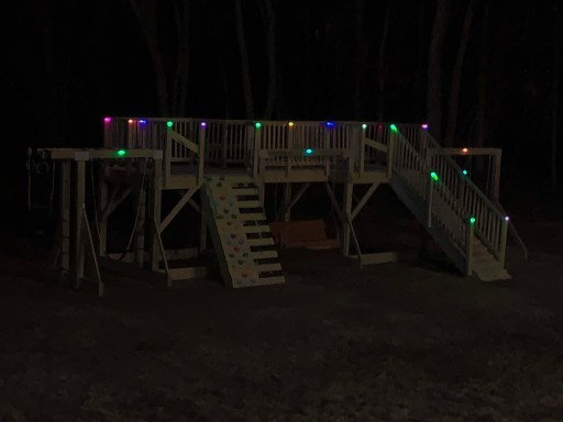 Color-changing solar deck lights on a playground at night