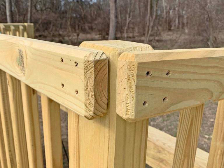 Handrails fastened to a playground using 4 inch deck screws
