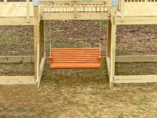 Porch swing hanging on a playground