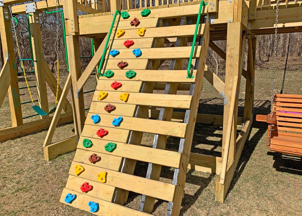 Rock climbing wall and step ladder on a playground