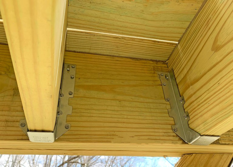 Simpson Strong-Tie LUS210Z joist hangers used to secure joists to the playground