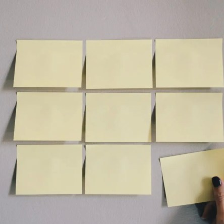 Nine post-its stuck to a wall