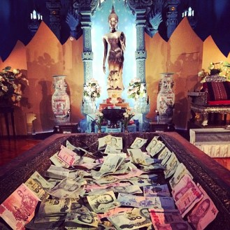 Money offered to Buddha. It is in a footprint of Buddha.