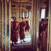 Monks gathered around Buddha's footprint.
