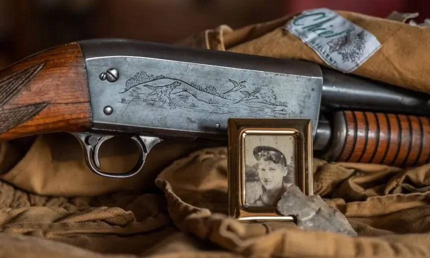 A pump shotgun and old hunting vest.
