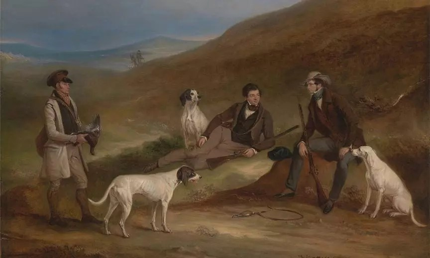 A group of bird hunters sits with their pointing dogs
