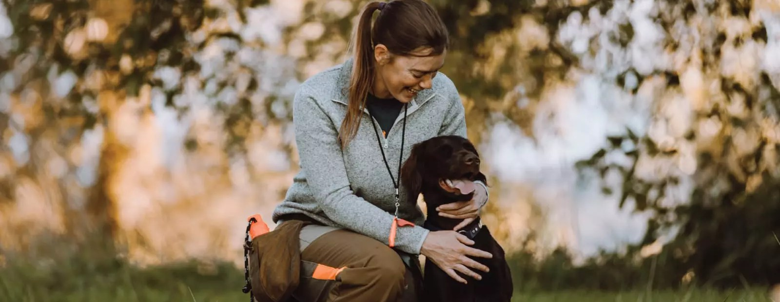 A bird hunter with her hunting dog
