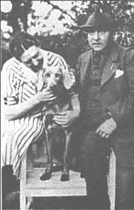 Major Robert Herber and his wife with a Weimaraner
