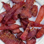 A plate of dehydrated pheasant jerky for a wild game recipe