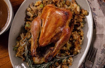 A roasted pheasant with cornbread stuffing and gravy