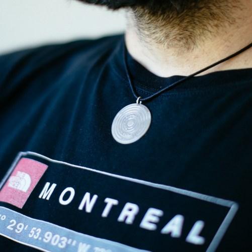 Men wearing custom solar system necklace