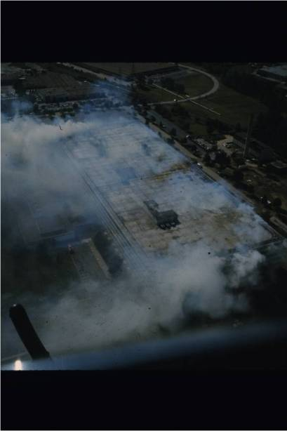 Smoke pours out from the roof of the huge building.