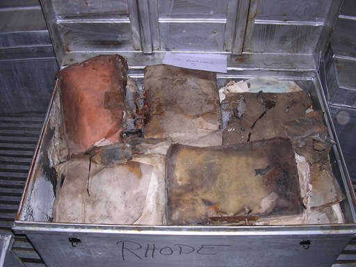 Items recovered from the flooded basement of the Mukhabarat, Saddam Hussein's intelligence headquarters, before treatment.