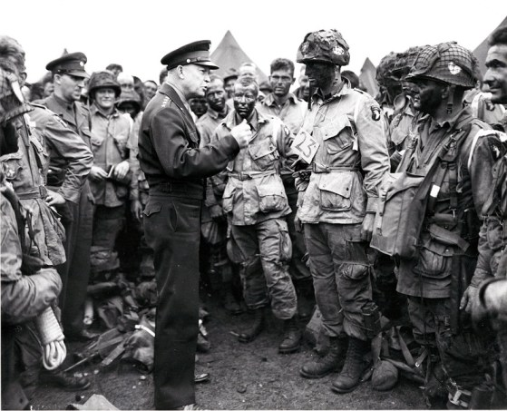 """General Dwight D. Eisenhower talks with paratroopers of the 101st Airborne Division in Newbury, England, on June 5, 1944, prior to their departure for their role in the D-day invasion, dropping behind enemy lines.  The soldier with a """"23"""" tag was a fellow Kansan, Lt. Wallace C. Strobel."""