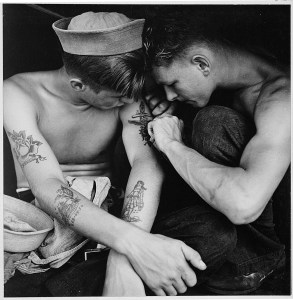 Much tattooed sailor aboard the USS New Jersey. 12/1944. (National Archives Identifier 520883)